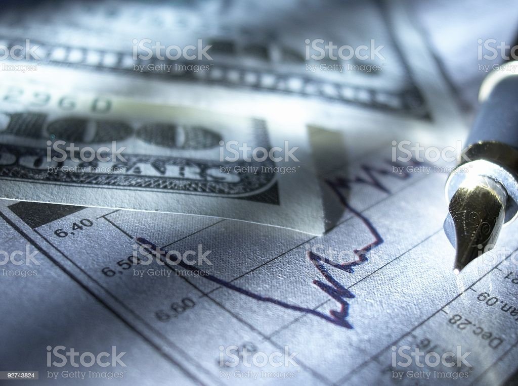 Fountain pen drawing on a stock page next to money royalty-free stock photo