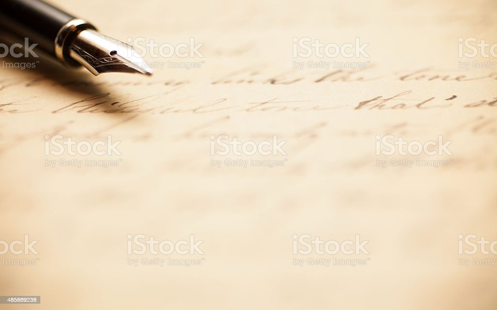 Fountain pen on an antique letter stock photo