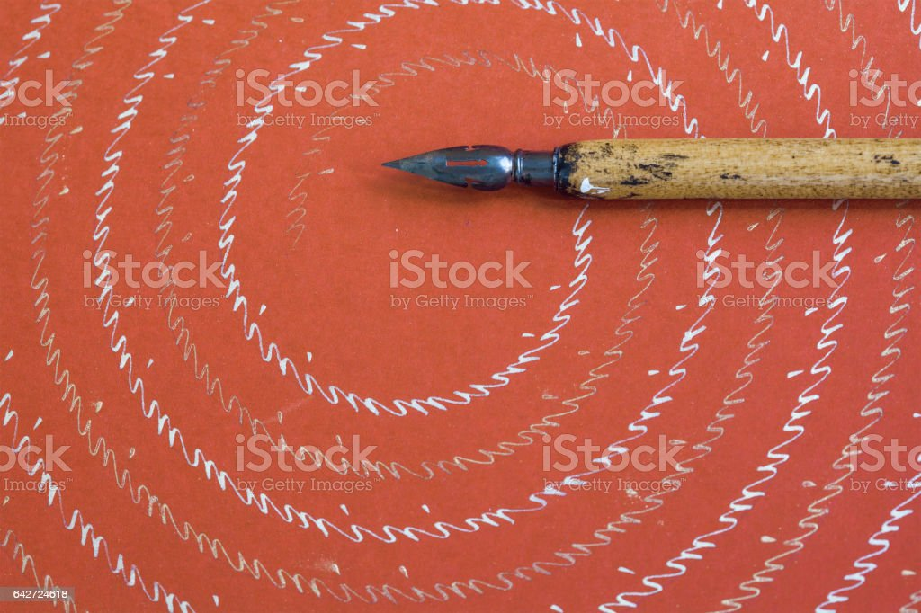 Fountain pen on red textured paper background with abstract letters pattern. Vintage design writing accessories macro view, shallow depth of field stock photo
