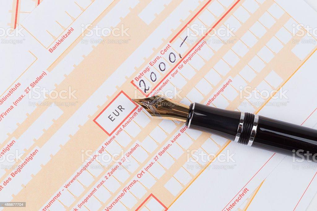 Fountain Pen on Remittance slip stock photo