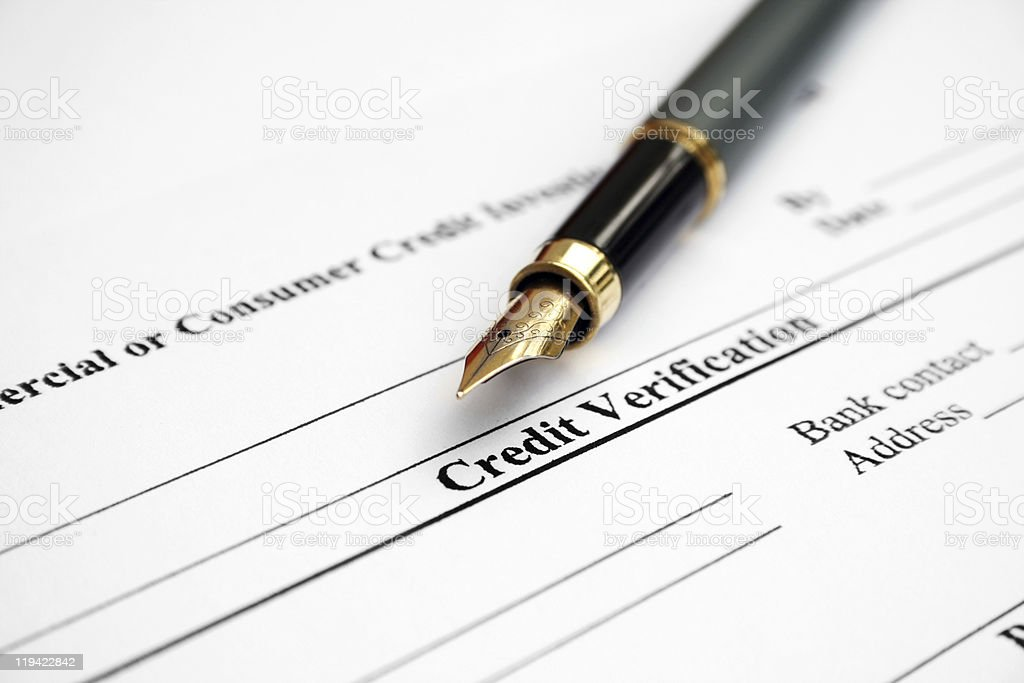 A fountain pen on top of a credit verification paper royalty-free stock photo