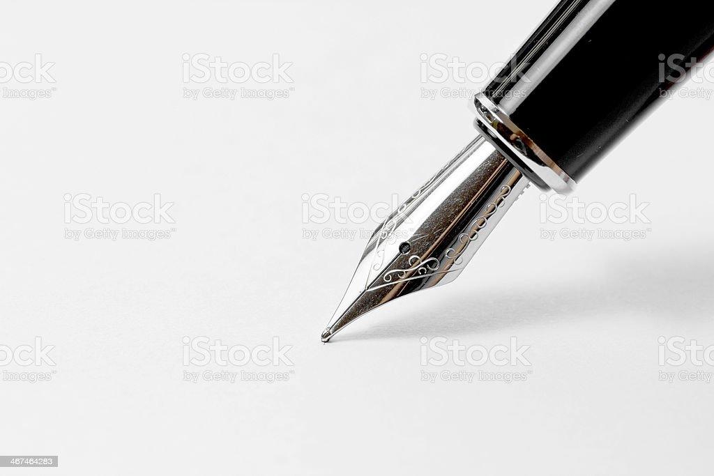 Fountain pen on white paper. stock photo
