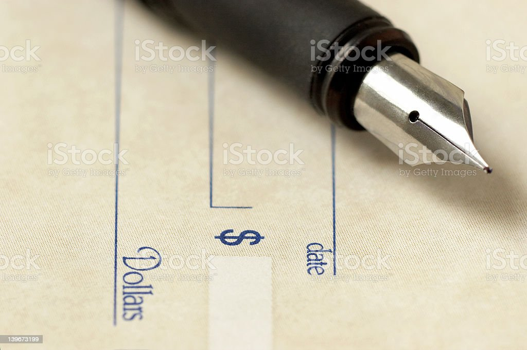 Fountain pen over check royalty-free stock photo
