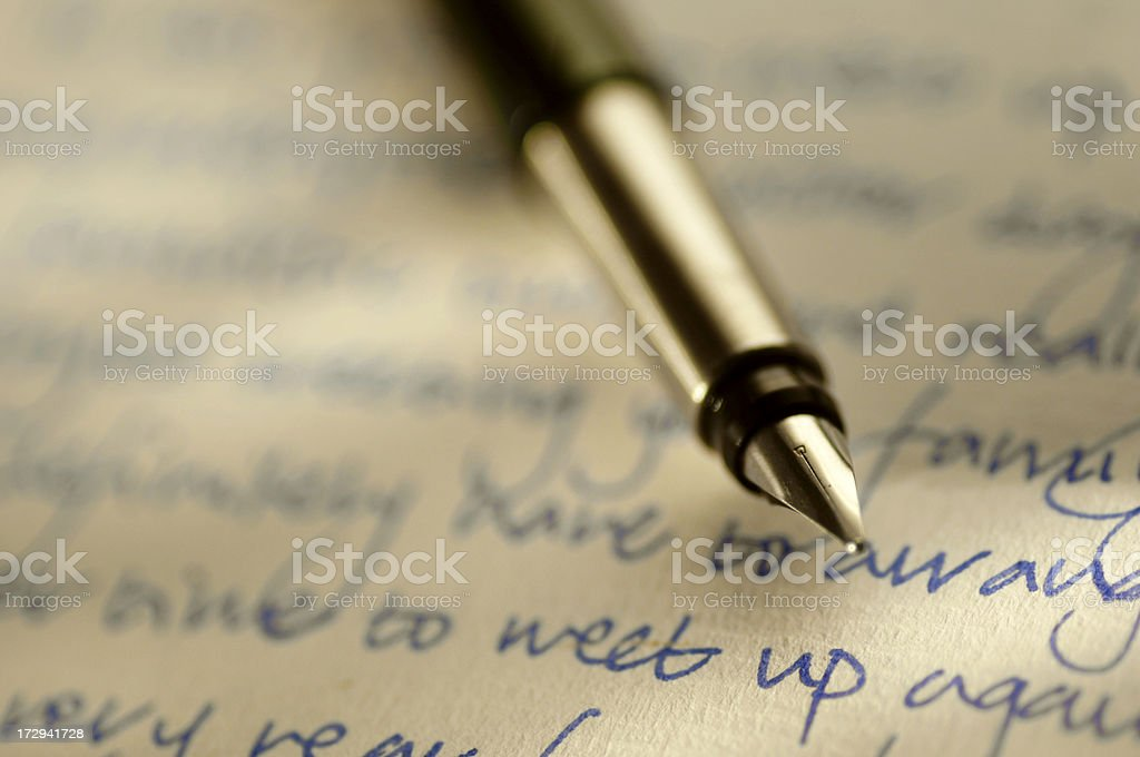 Fountain Pen Resting on Handwritten Letter royalty-free stock photo