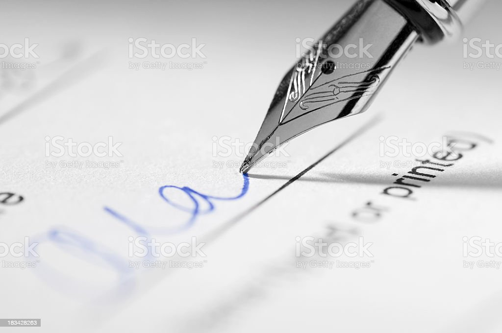 Fountain pen signing signature on paperwork stock photo