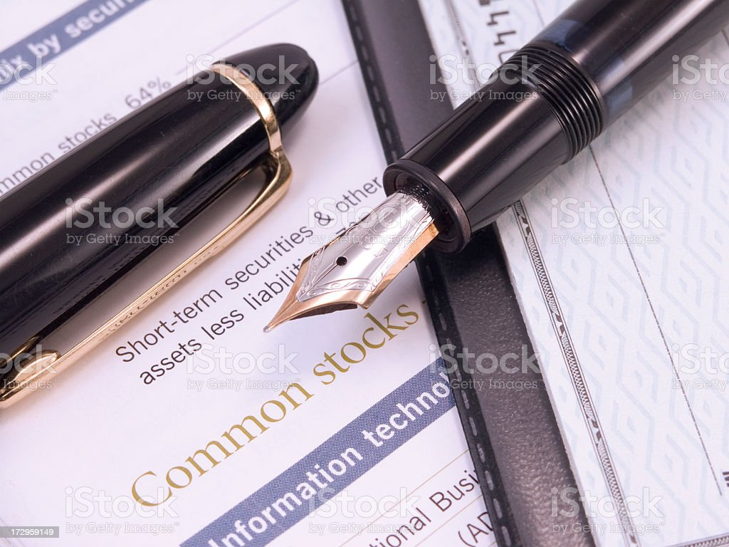 fountain pen, stocks and check book royalty-free stock photo