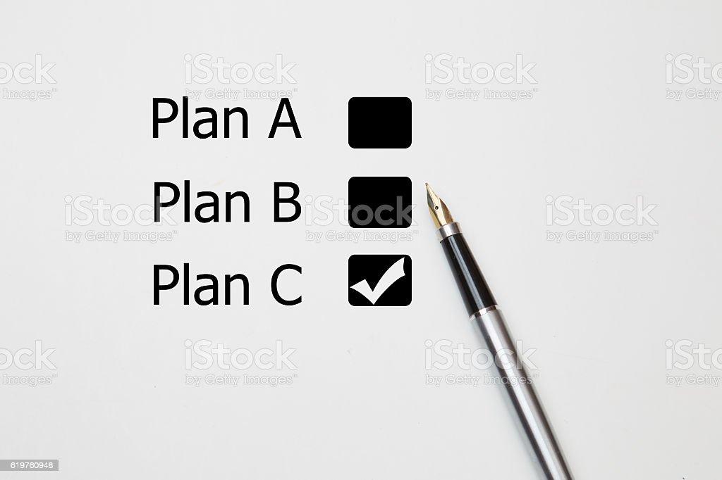 fountain pen Tick in Plan C checkbox stock photo
