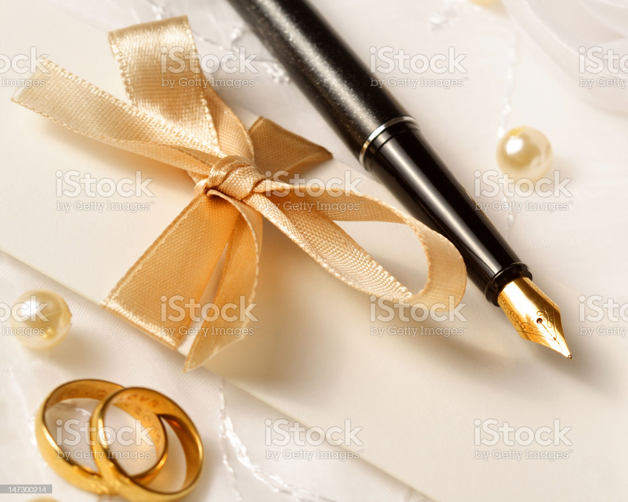 Fountain pen wedding invitation and gold wedding rings royalty-free stock photo