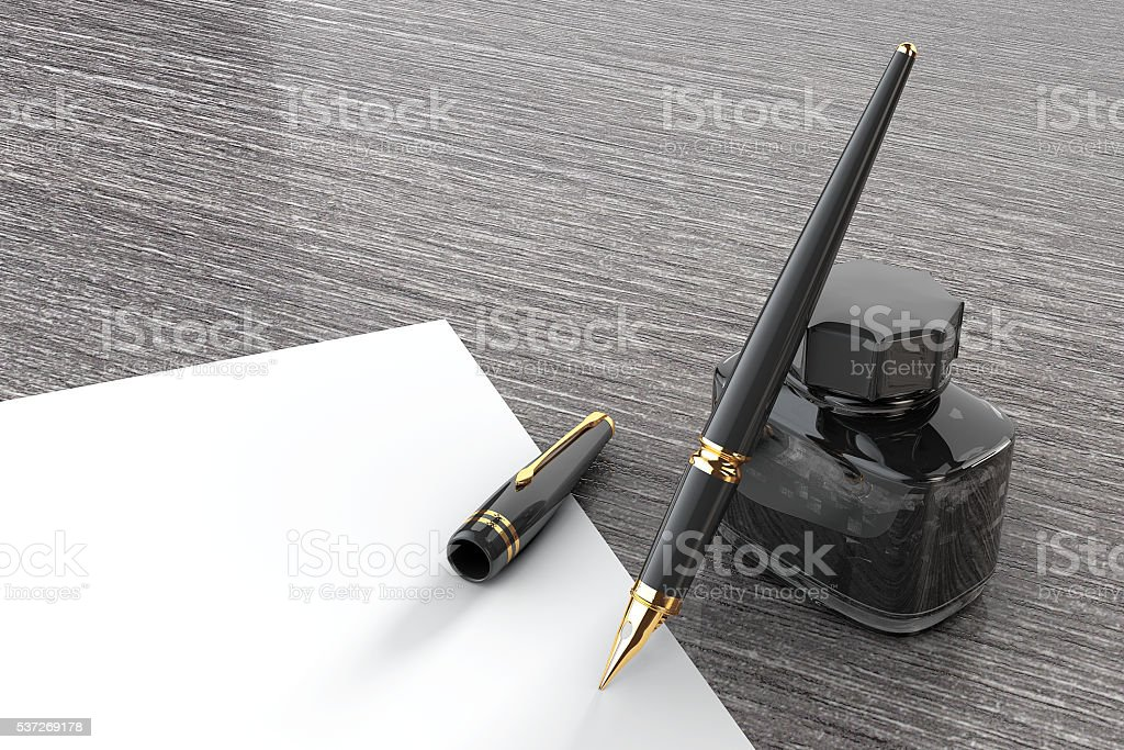 Fountain Pen with Ink Bottle on a wooden table stock photo