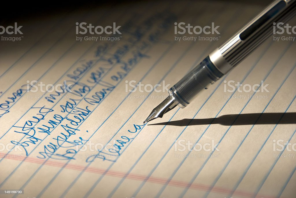 Fountain pen writing a personal letter royalty-free stock photo