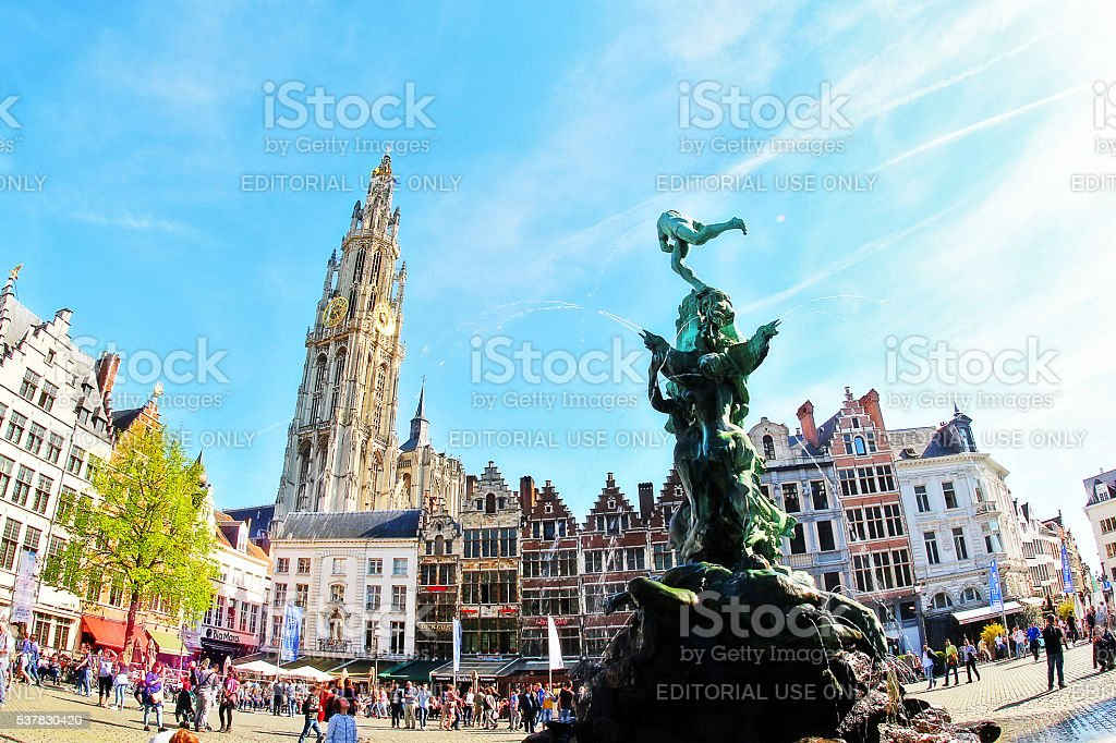 Fountain statue of Brabo and Cathedral of Our Lady (Onze-Lieve-Vrouwekathedraal) stock photo