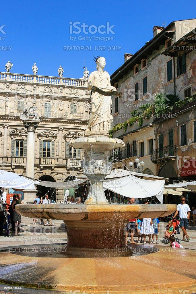Fountain, Tourists and Palazzo Maffei, Piazza delle Erbe, Verona, Italy. stock photo