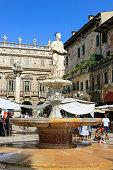 Fountain, Tourists and Palazzo Maffei, Piazza delle Erbe, Verona, Italy.