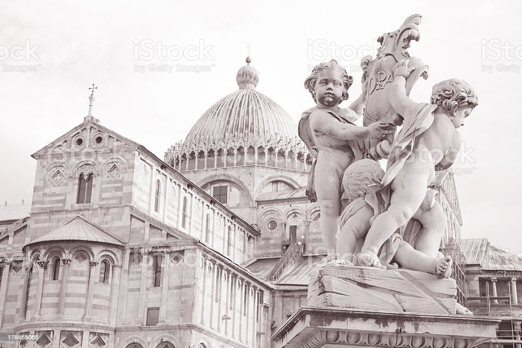 Fountain with Angels and Cathedral in Pisa, Italy stock photo