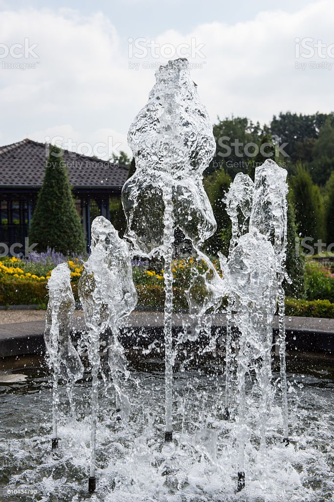 fountain with water and drops in public park stock photo