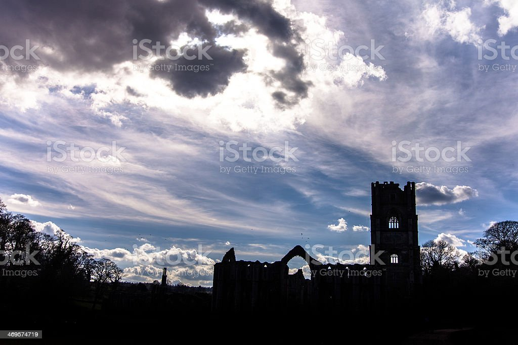 Fountains Abbey Silhouette against the evening sky stock photo