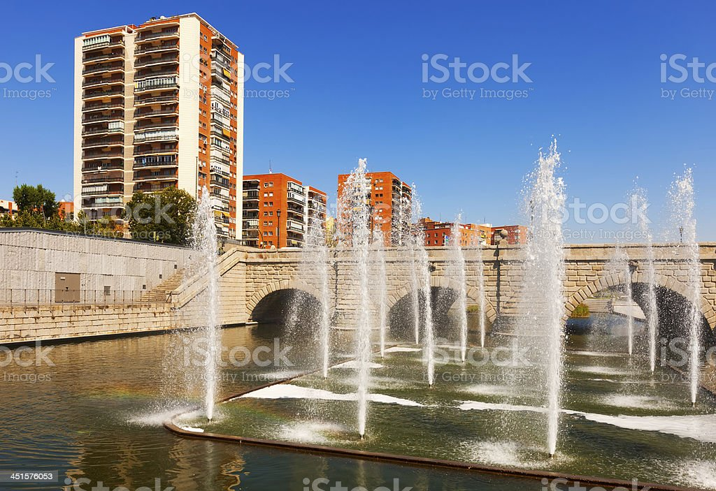 fountains and bridge over Manzanares river in  Madrid stock photo