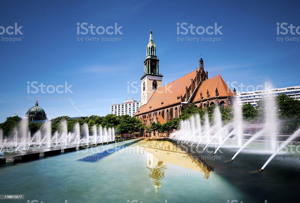Fountains on Alexanderplatz and St. Mary's Church royalty-free stock photo