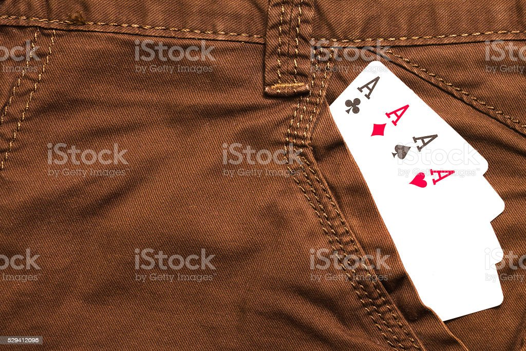 four ace cards inside brown jeans front pocket stock photo