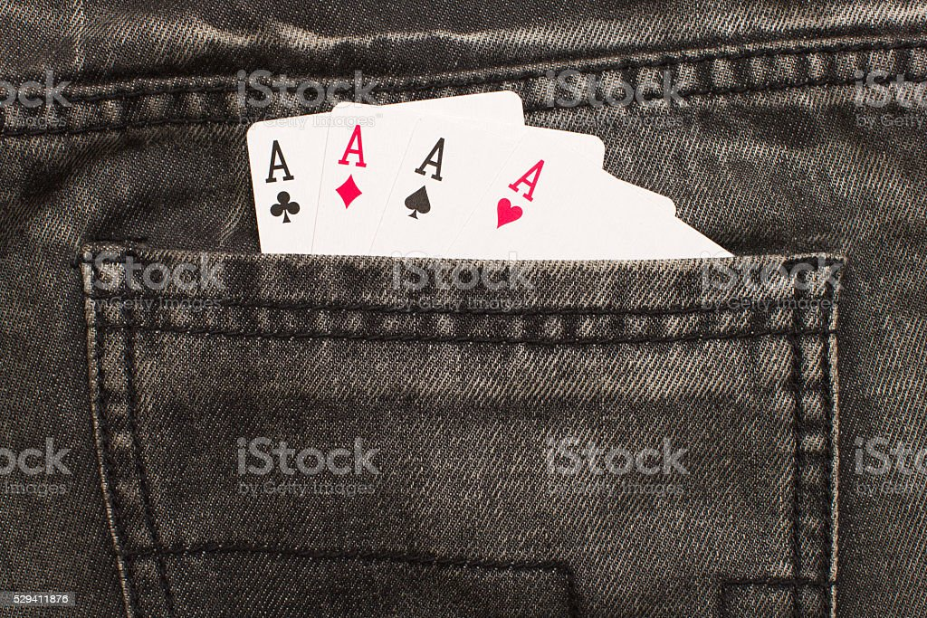 four ace cards inside gray jeans back pocket stock photo