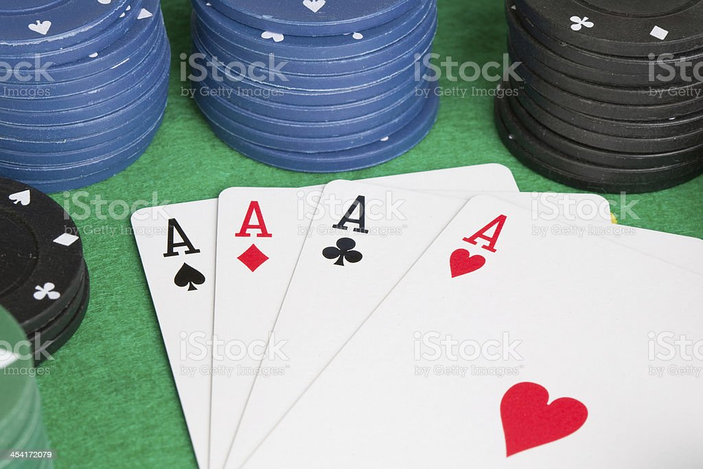 Four aces and poker stacked chips royalty-free stock photo