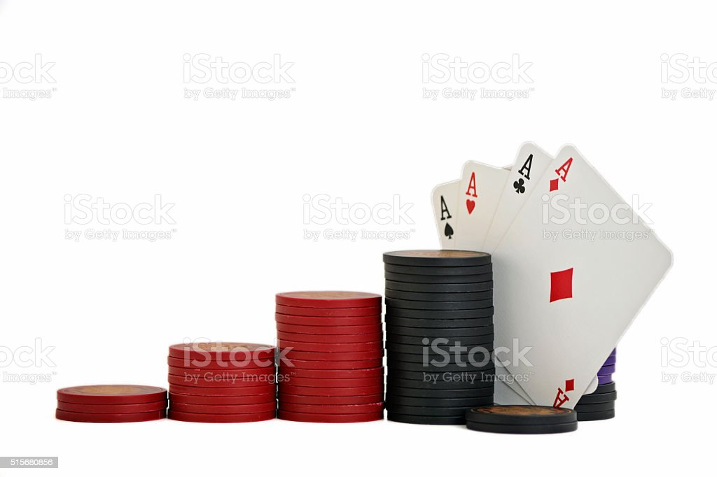 Four aces and stacked chips stock photo