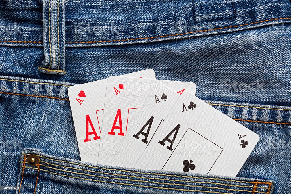 Four aces in denim pocket stock photo