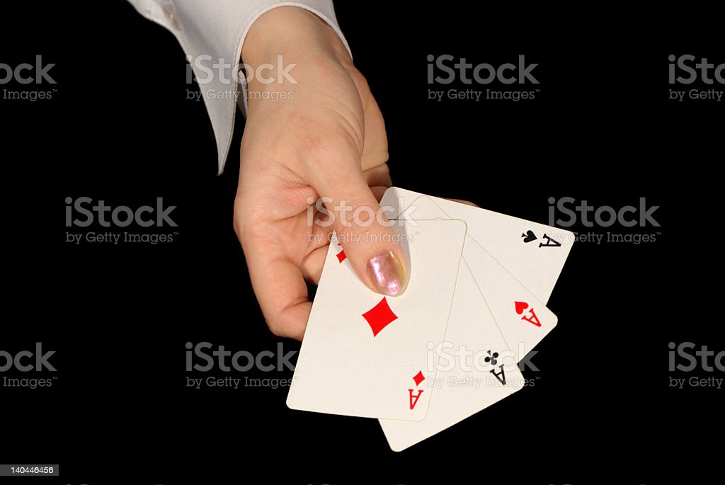 four aces in female hand on black royalty-free stock photo