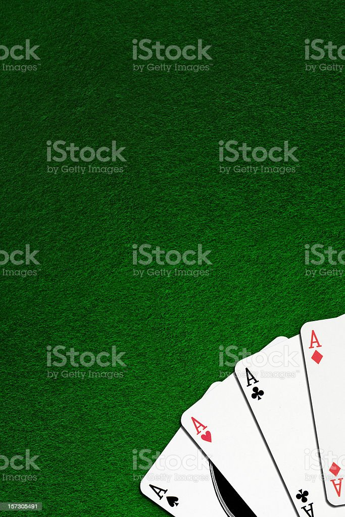Four Aces on green felt - copyspace royalty-free stock photo