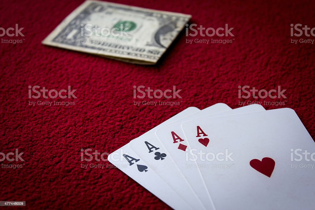 Four aces  on red background stock photo