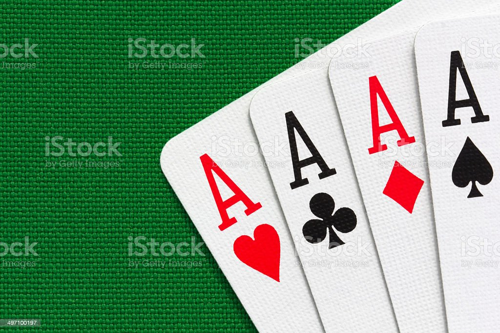 Four aces over green textile background stock photo