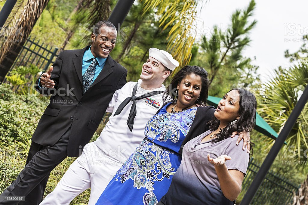 Four Adult Friends Walking Together Arm-in-Arm royalty-free stock photo