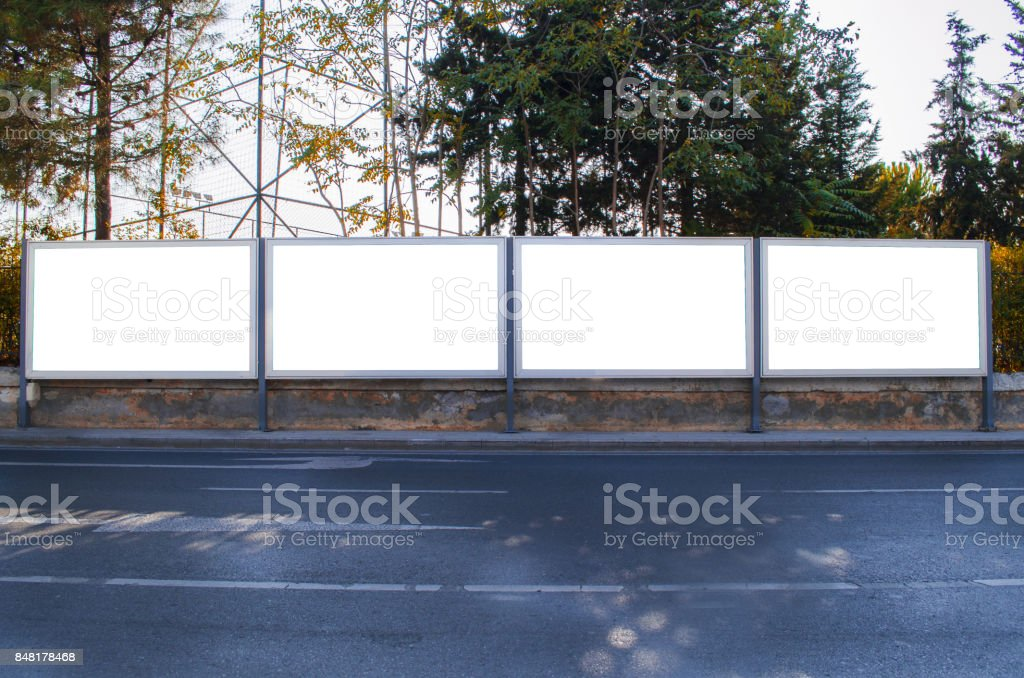four advertising panels side by side stock photo