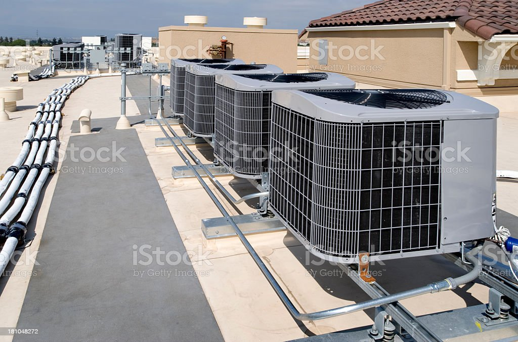 Four air conditioning units outside stock photo