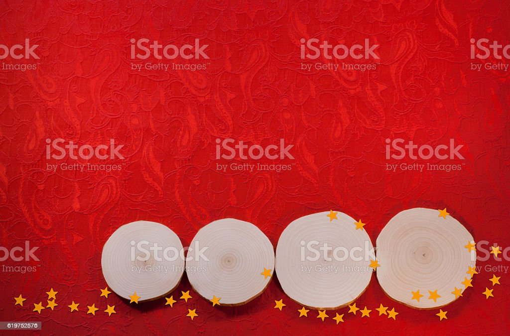 Four alder saw cuts and yellow asterisks on red fabric. stock photo