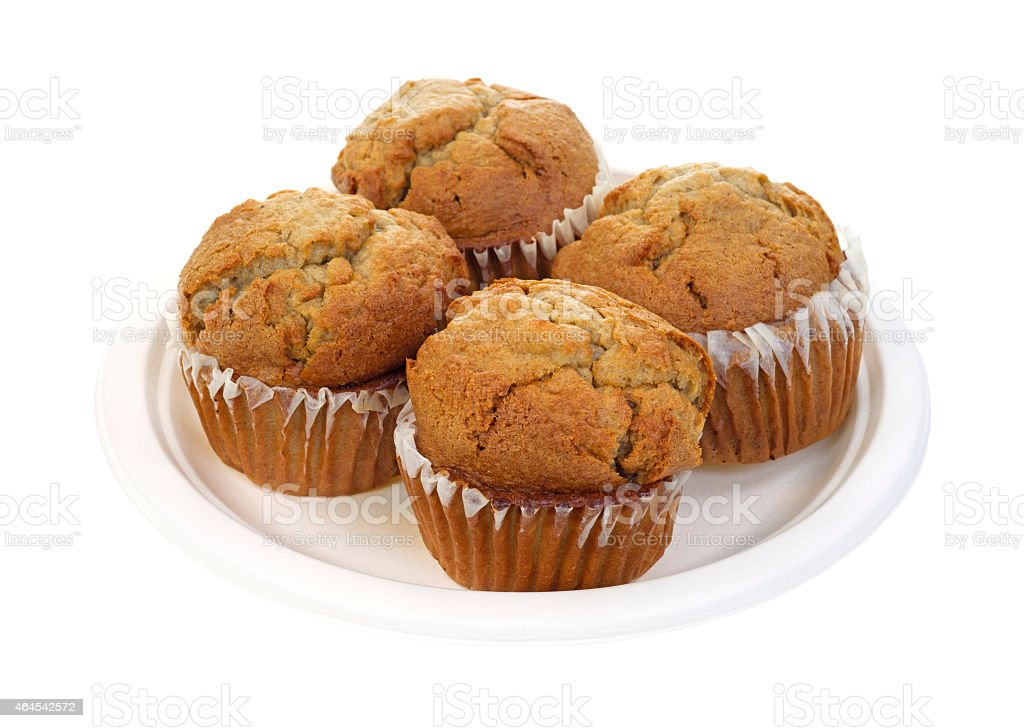 Four apple spice muffins stock photo
