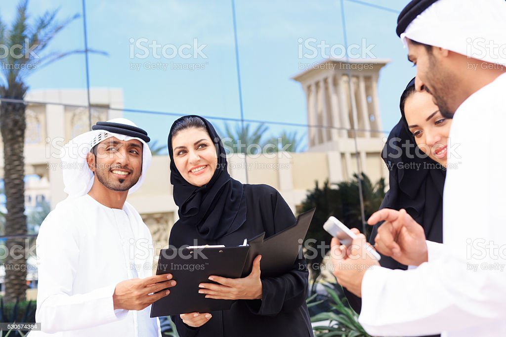 Four arab business people outside stock photo