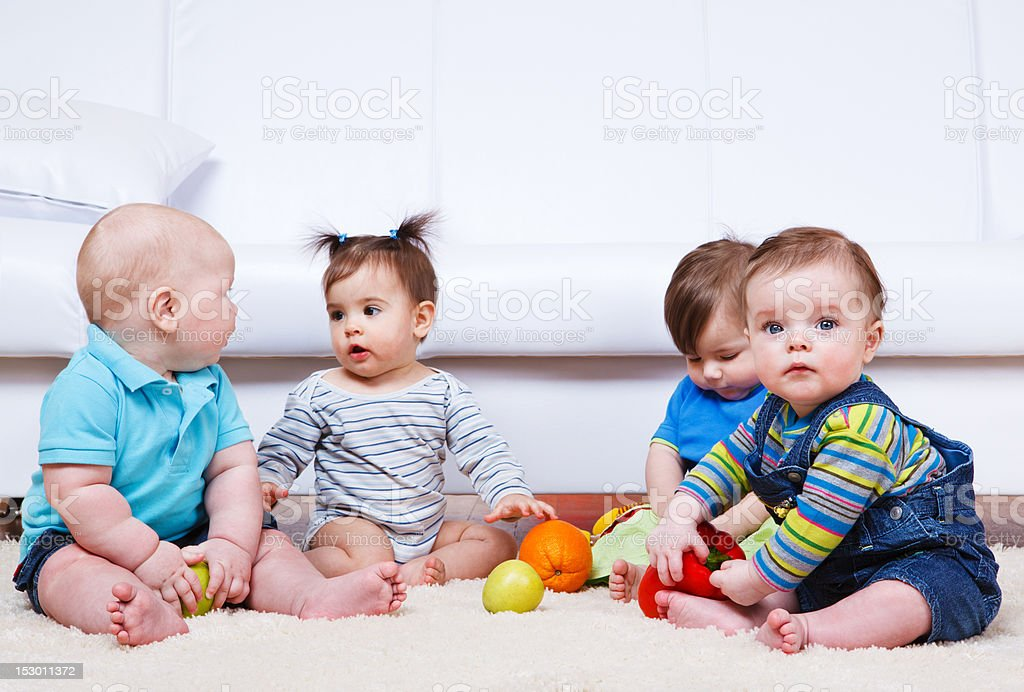 Four babies group royalty-free stock photo
