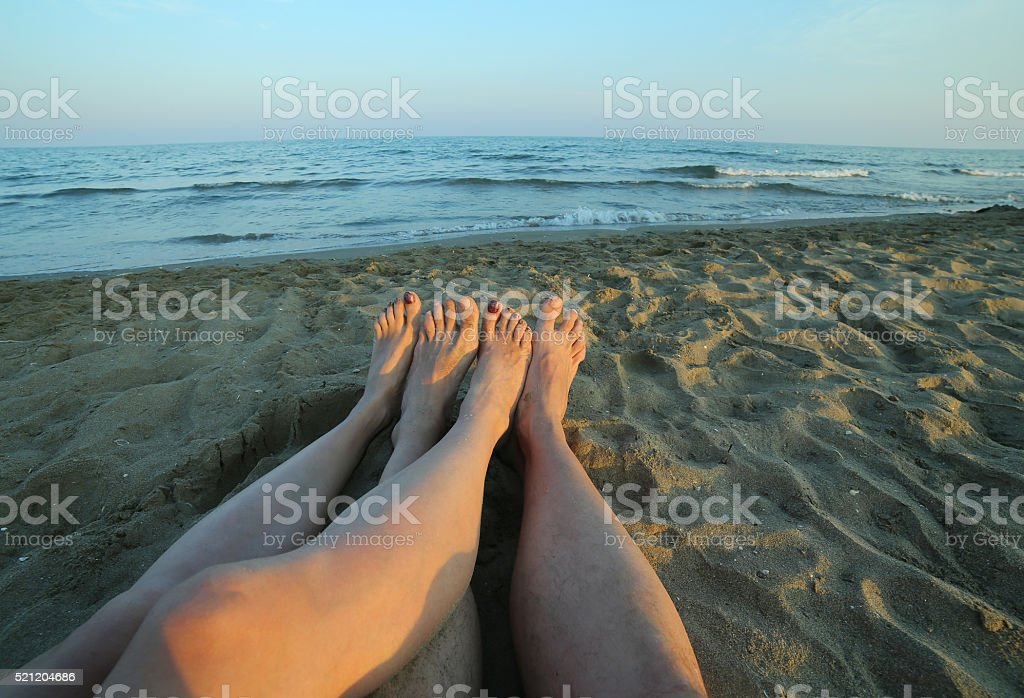 four bare feet of the couple in love stock photo