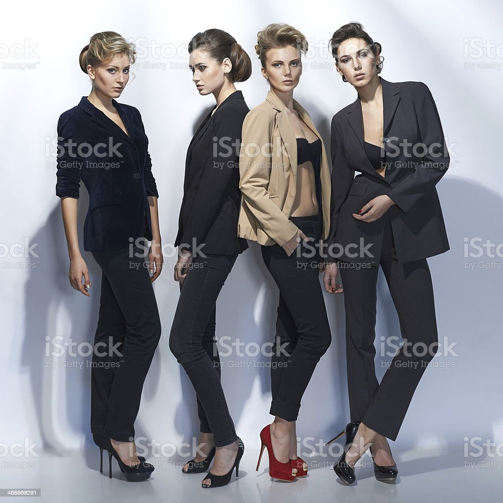 Four beautiful girls in fashion style stock photo