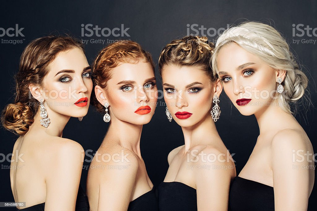 Four beautiful girls with make-up stock photo