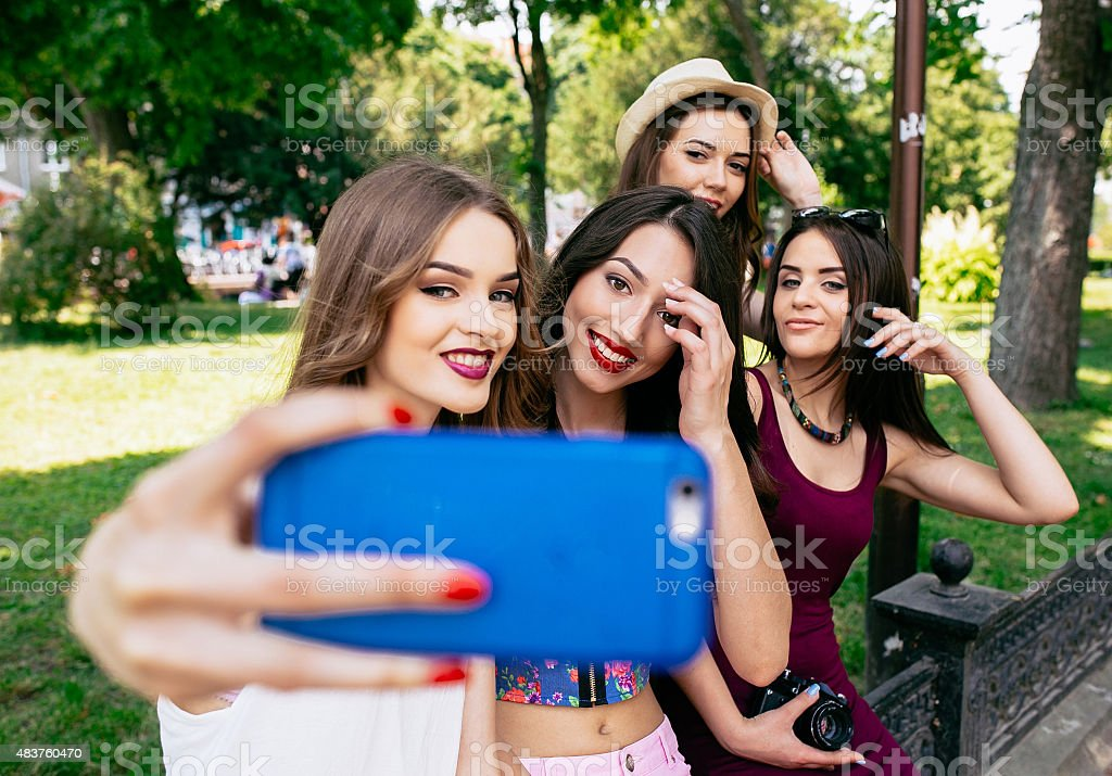 four beautiful young girls make selfie stock photo