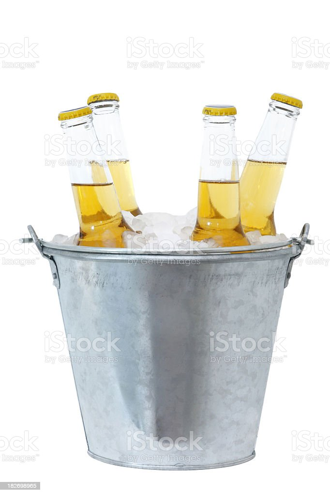 Four beer bottles in ice in a metal bucket  stock photo