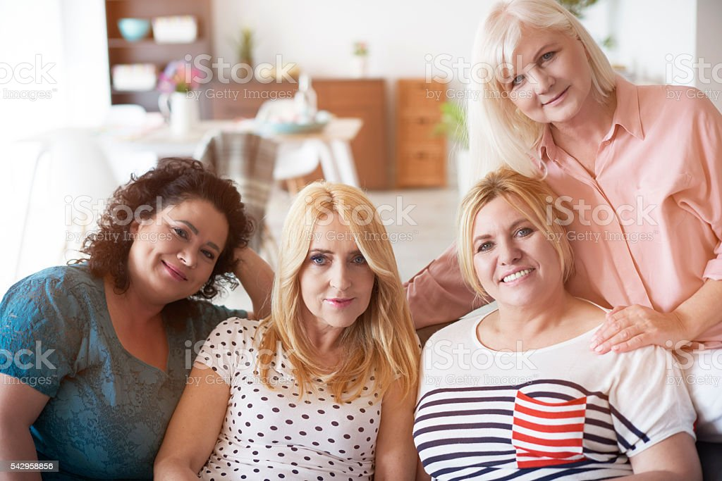 Four best and mature friends stock photo