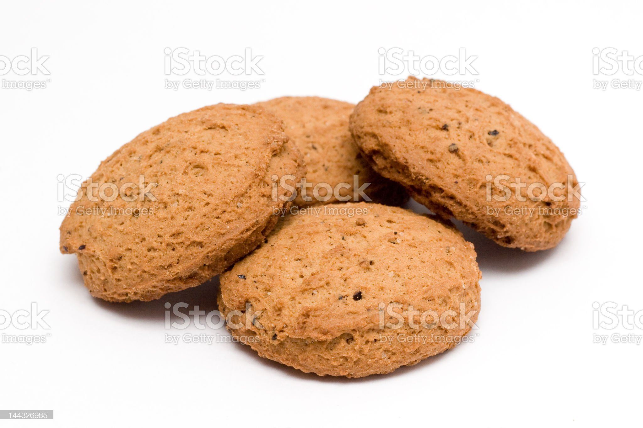 Four biscuits, isolated, close view royalty-free stock photo