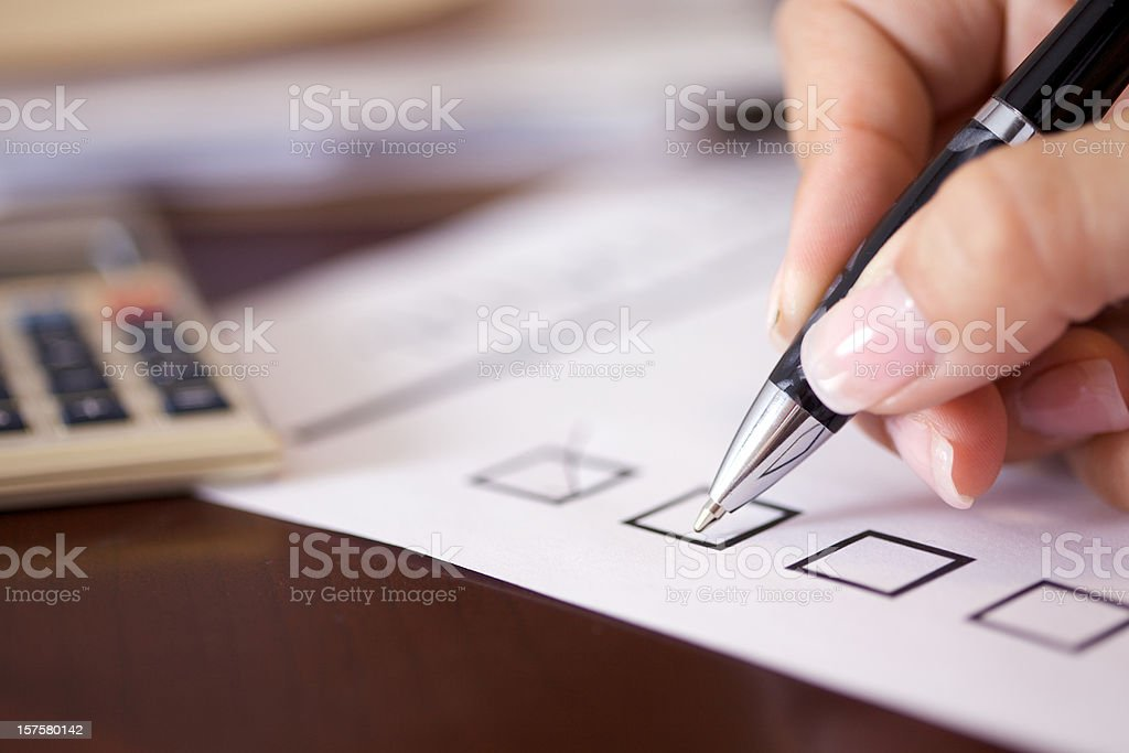 Four black checkboxes with one ticked royalty-free stock photo