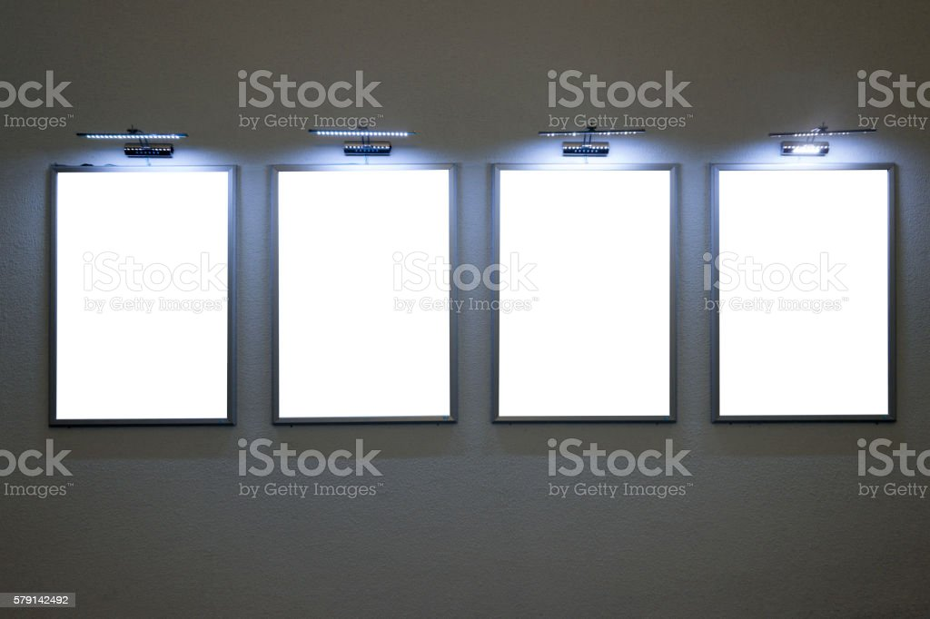 Four Blank Billboards on Wall stock photo