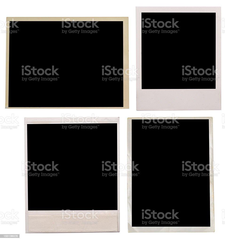 Four blank black old photographs stock photo