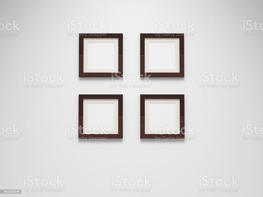 four blank picture frames on wall stock photo