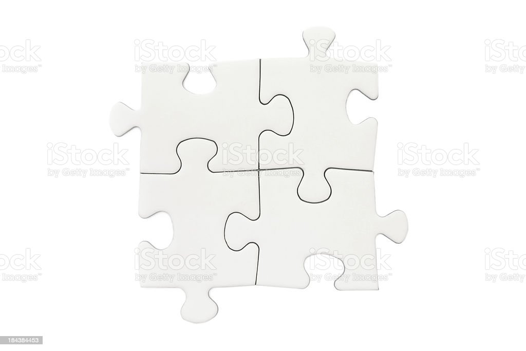 Four Blank Puzzle Pieces stock photo